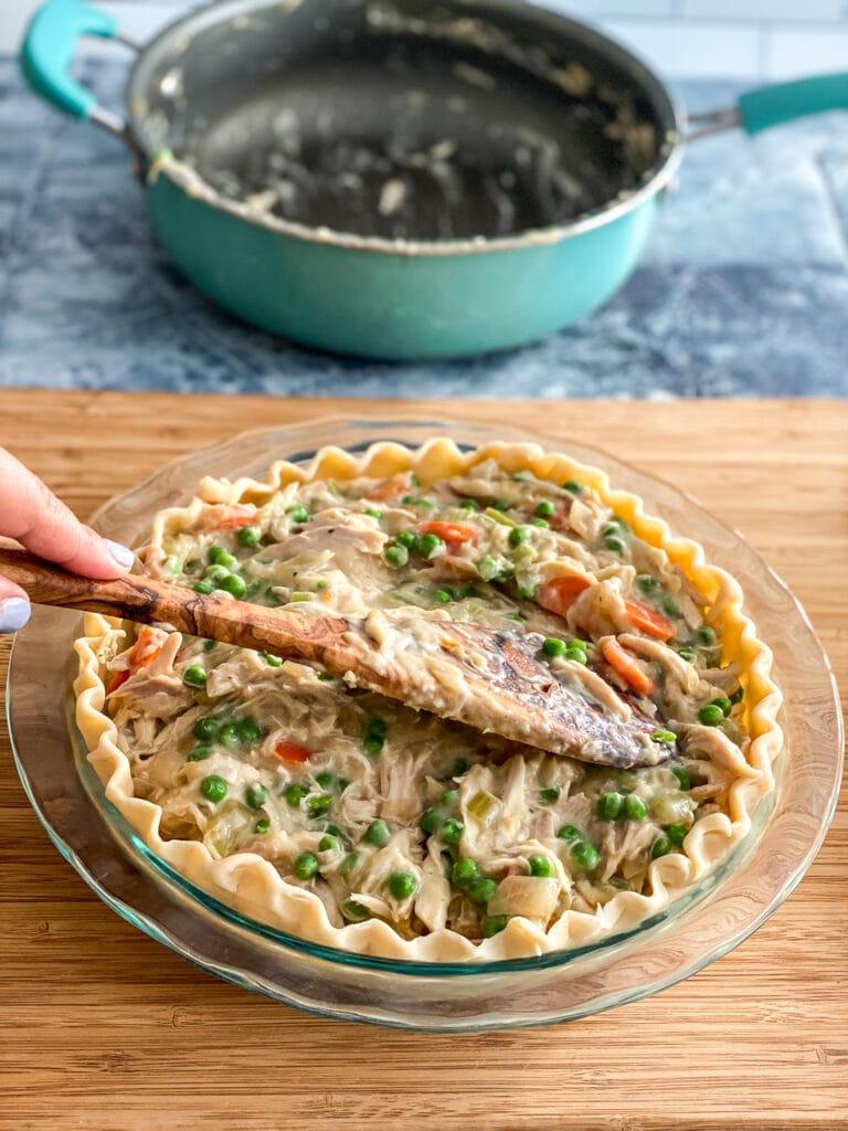 turkey pot pie filling inside of the bottom crust