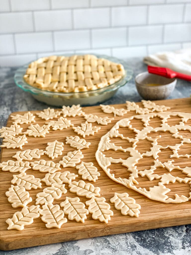 extra pie crust cut into leaf designs with cookie cutter