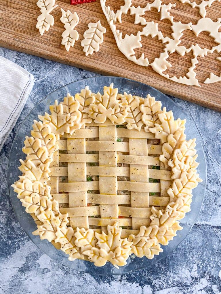 turkey pot pie with top lattice crust and leaf crust designs unbaked