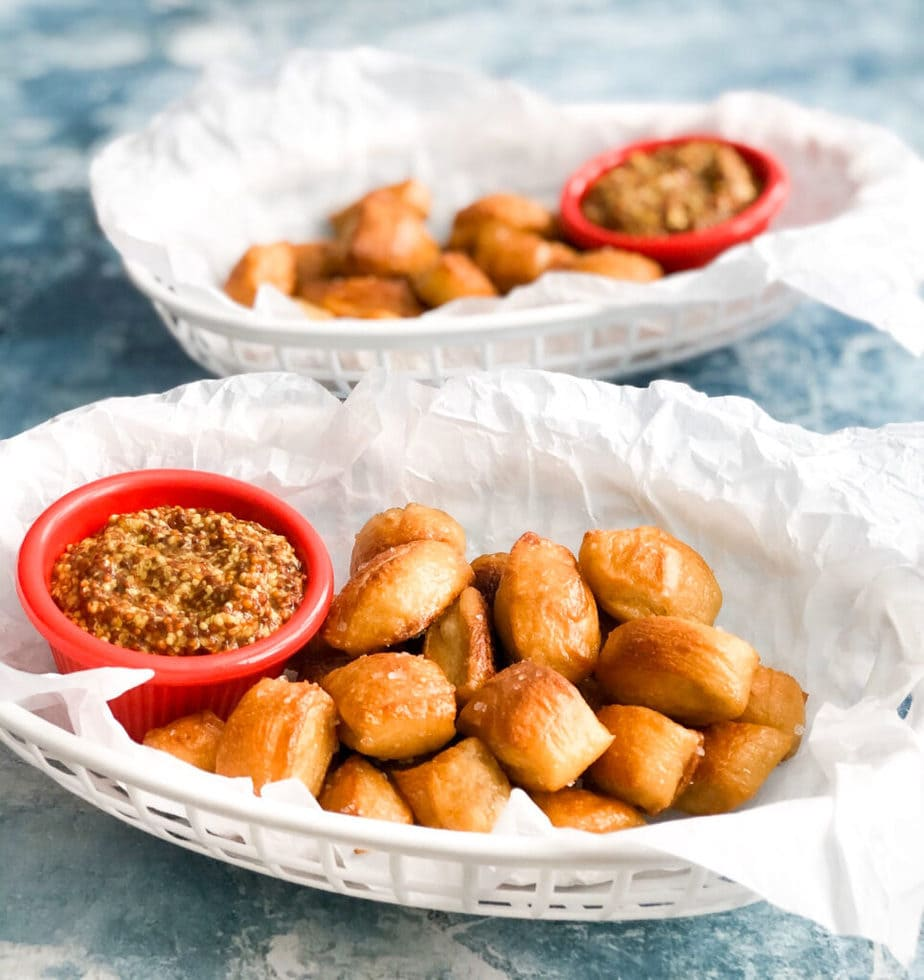 short cut pretzel bites in plastic serving tray with side of mustard