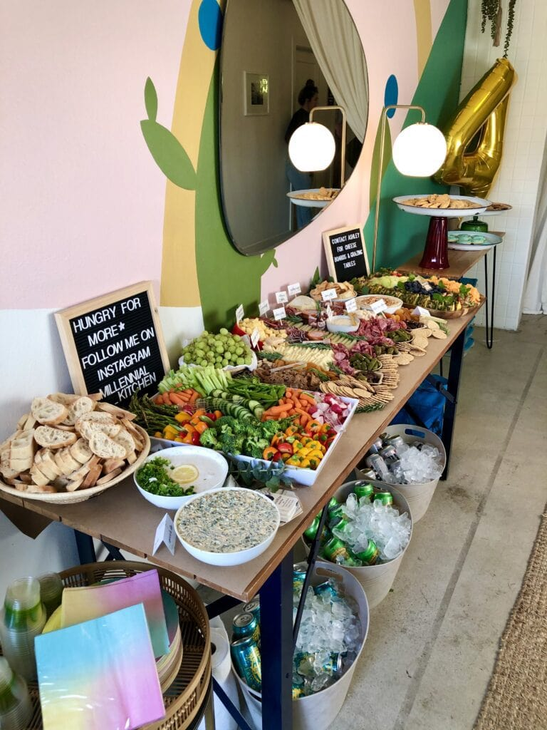 grazing table with charcuterie and other treats