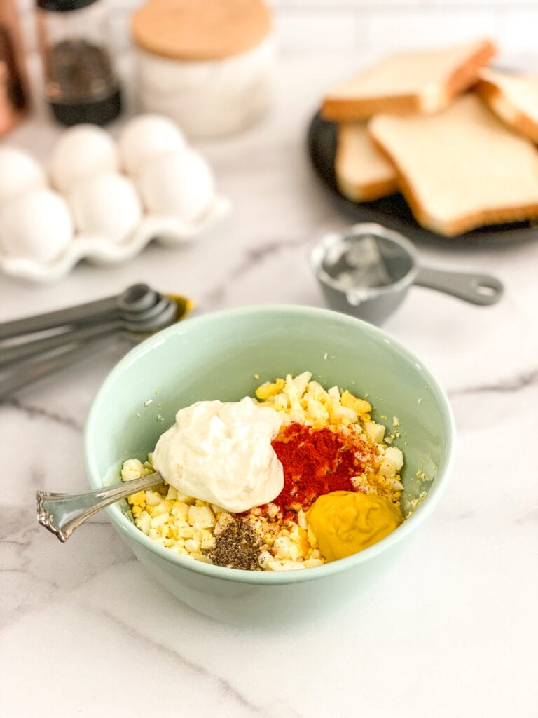 bowl of chopped eggs with other ingredients to make egg salad