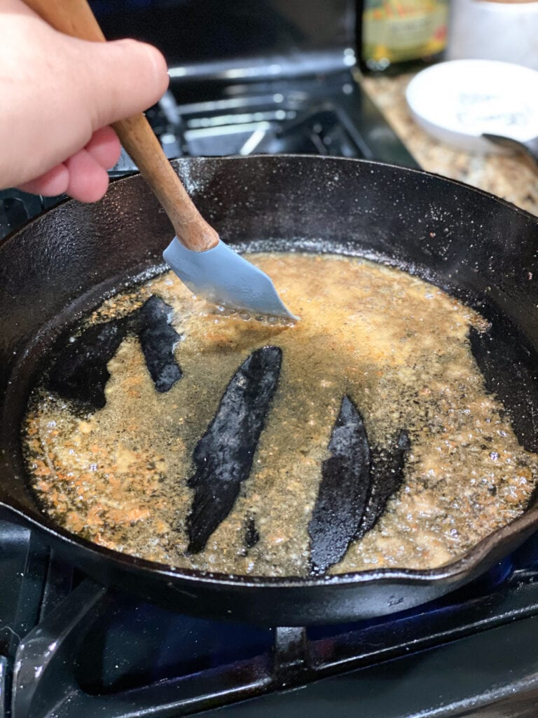 white wine simmering in cast iron skillet