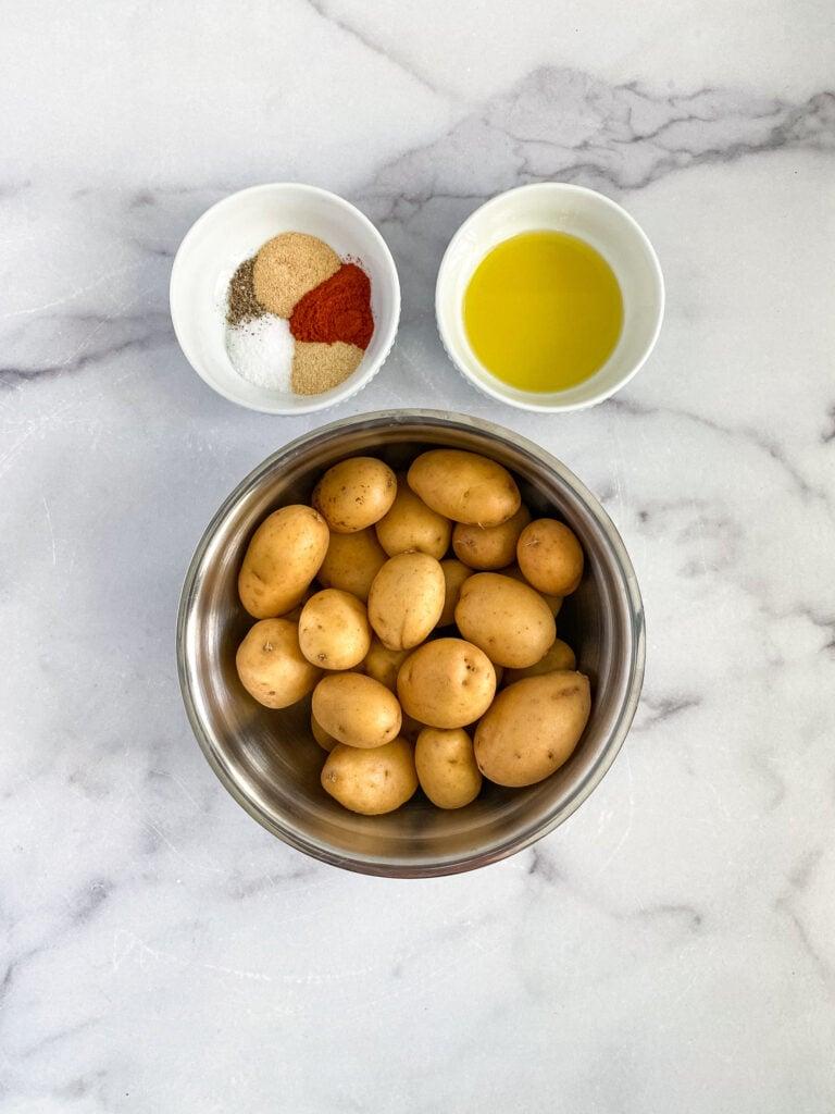 ingredients for breakfast potatoes: potatoes, seasoning mixture, olive oil