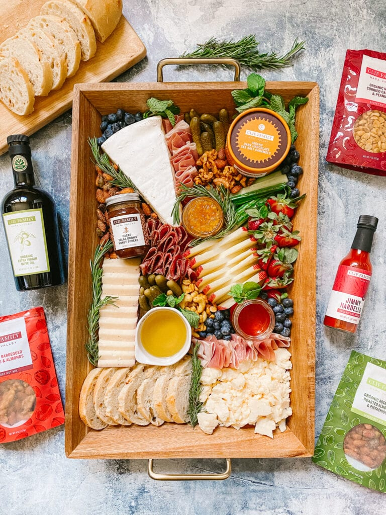 Clif Family inspired cheeseboard with some of their food items, cheeses, meats & fresh fruit