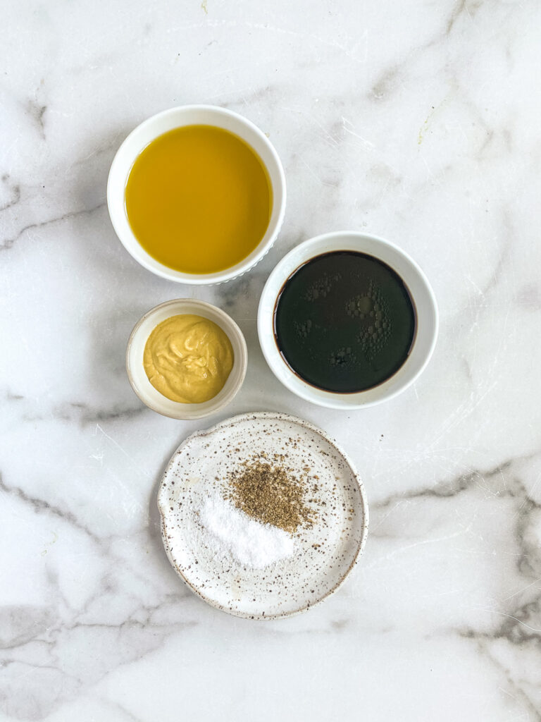 creamy balsamic dijon dressing ingredients measured out in small dishes ready to be made into dressing